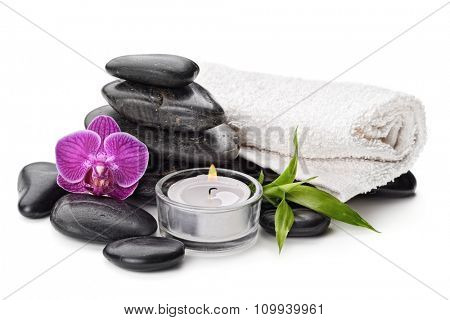 spa concept with zen basalt stones , orchid and candle isolated on white
