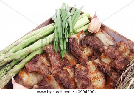 beef meat grilled ribs with asparagus and tomatoes isolated over white background