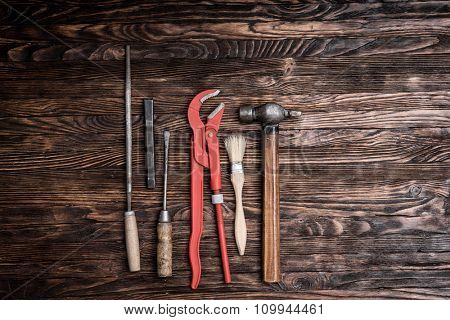 set of repairing tools on wooden background