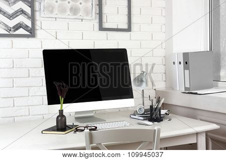 Stylish workplace with computer in home or office