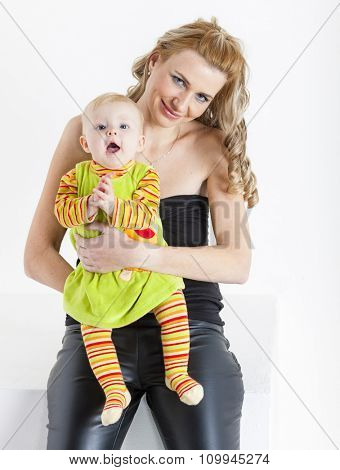 portrait of mother with her baby girl