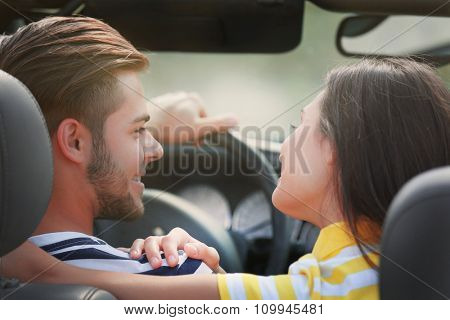 Couple in the car outside