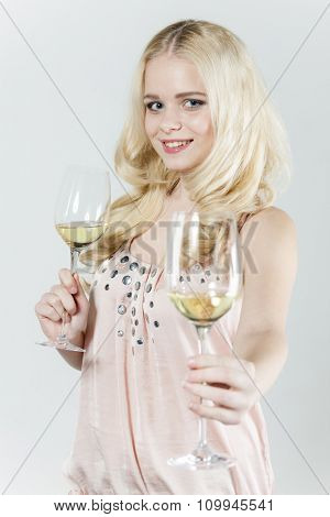 portrait of young woman with glasses of white wine