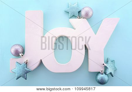 Christmas Wooden Word, Joy On Blue Background.