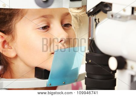 Small girl visit an optician