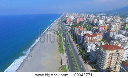 Highway D-400 near sea beach in Alania resort city at summer sunny day. Aerial view videoframe