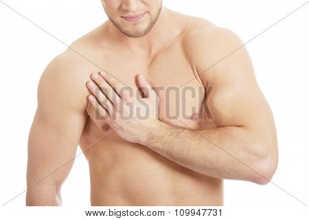 Handsome athletic man suffering from chest pain.