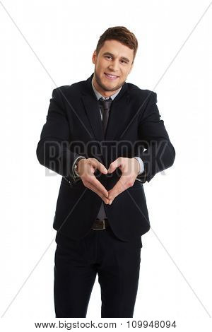 Businessmn making heart shape by his hands.