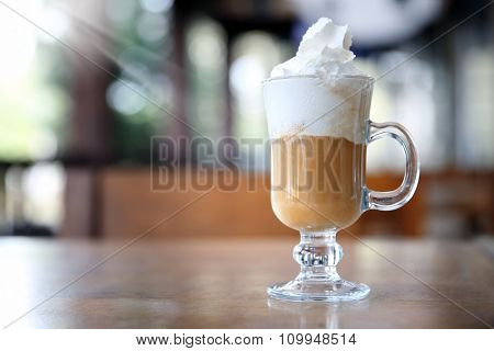 Iced coffee on table in cafe
