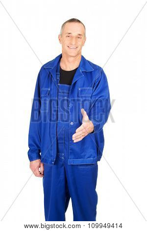 Mature repairman ready to handshake.