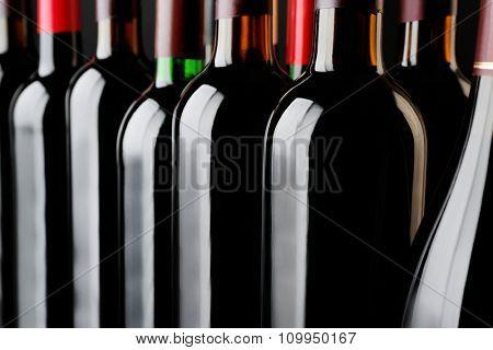 Wine bottles background, close up