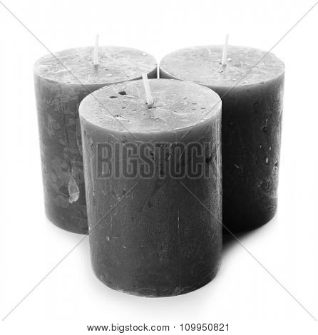 Wax grey candles isolated on white background