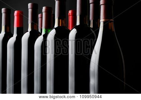 Wine bottles on black background