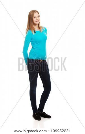 Happy teen woman standing with toothy smile
