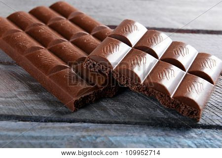 Chocolate on wooden background closeup