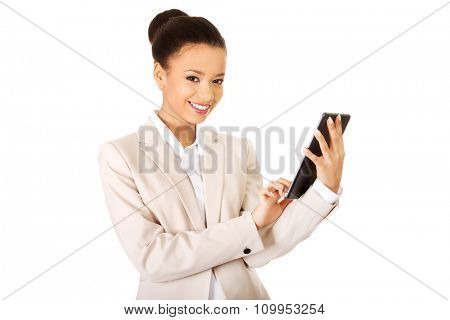 Beautiful african business woman with the tablet.