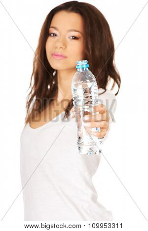 African woman holding a bottle of water.