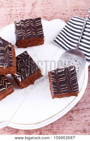 Served table with chocolate cakes on wooden background close-up