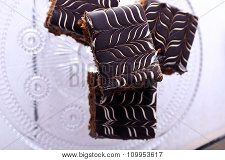 Served table with chocolate cakes on white wooden background