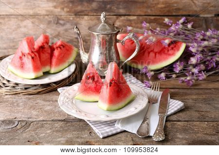 Fresh sliced watermelon on decorated wooden background