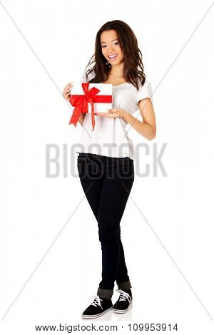 Attractive african woman with gift box.