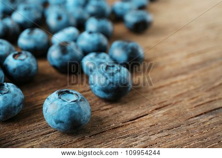 Fresh blueberries on wooden table, closeup