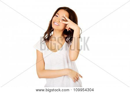 Happy african teenager woman showing victory sign