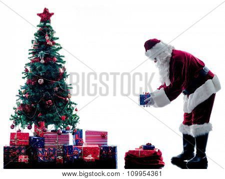 one santa claus man and christmas tree  silhouette isolated on white background