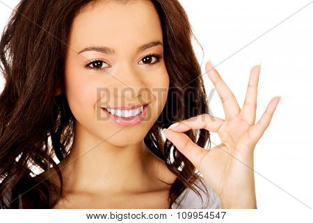 Young african woman showing perfect sign.
