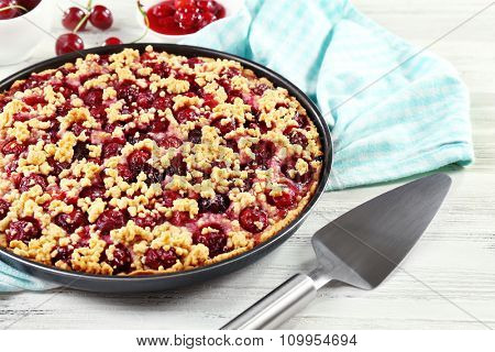 Tasty homemade pie with cherries on table close up