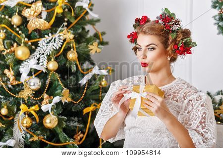 Girl Is Holding A Christmas Present.