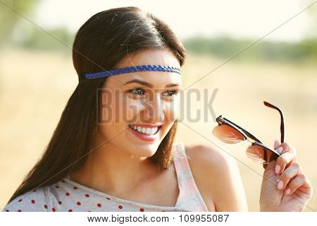 Beautiful smiling woman with sunglasses, outdoors
