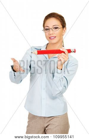Happy businesswoman holding big pencil.