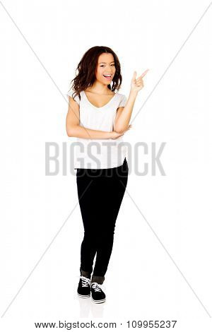 Young student african woman pointing up.