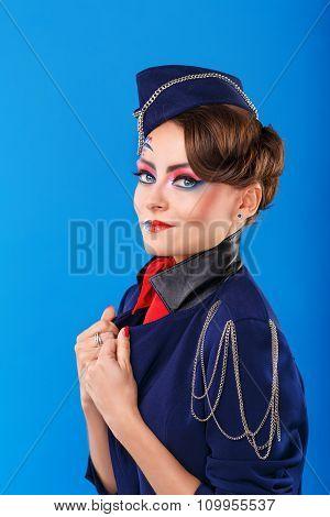 Stewardess With Face Art Corrects Jacket.
