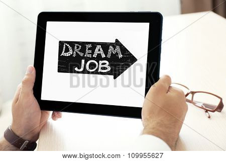 Dream job concept. Male hands holding tablet, close-up