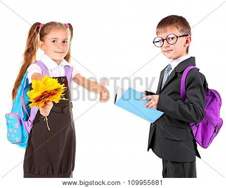 Cute school girl and schoolboy, isolated on white