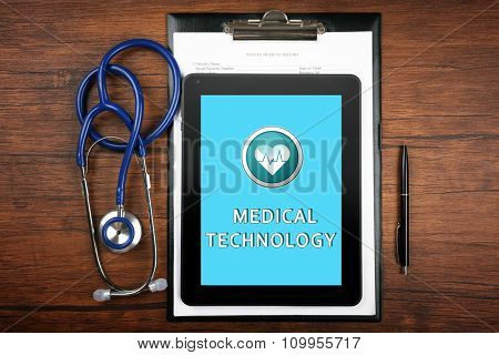 Tablet-pc on doctor table, concept of medical technology