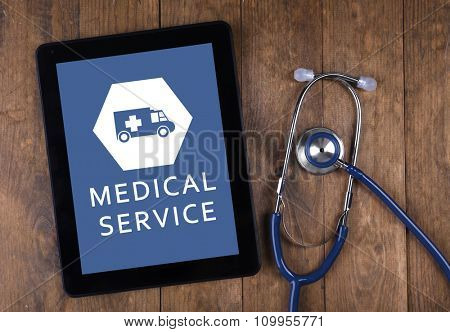 Tablet-pc on doctor table, concept of medical service