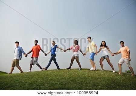 Group Friends Outdoors Holding Hands Unity Concept