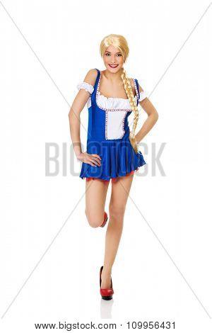 Oktoberfest woman wearing traditional Bavarian dress.