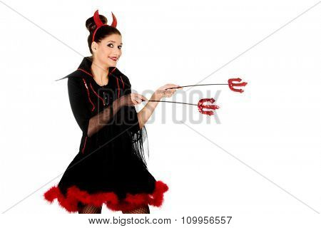 Beautiful devil woman pointing aside with trident.