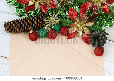 Blank beige paper to write wish lists with glittery Christmas decoration