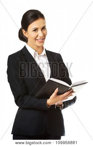 Smiling businesswoman reading her notes.