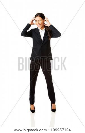 Agressive businesswoman screaming and pulling head.