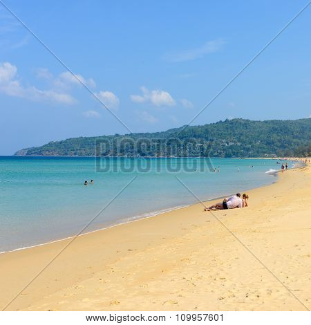 The Tourists Are Relaxing On The Karon Beach