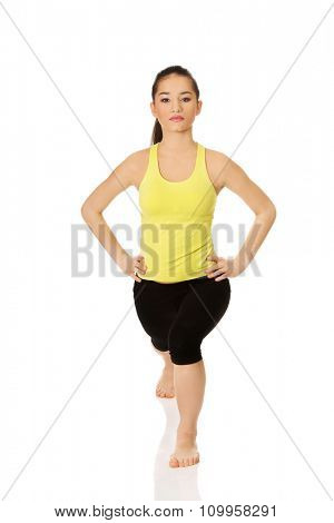 Young fitness woman doing stretching exercise.