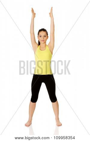 Young fitness woman doing fitness exercise.