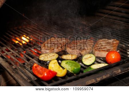 Meat and vegetables on charcoal grill