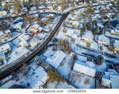 FORT COLLINS, CO, USA - NOVEMBER 29, 2015: Aerial  view of typical residential neighborhood along Front Range of Rocky Mountains in Colorado, late fall or winter scenery with snow.